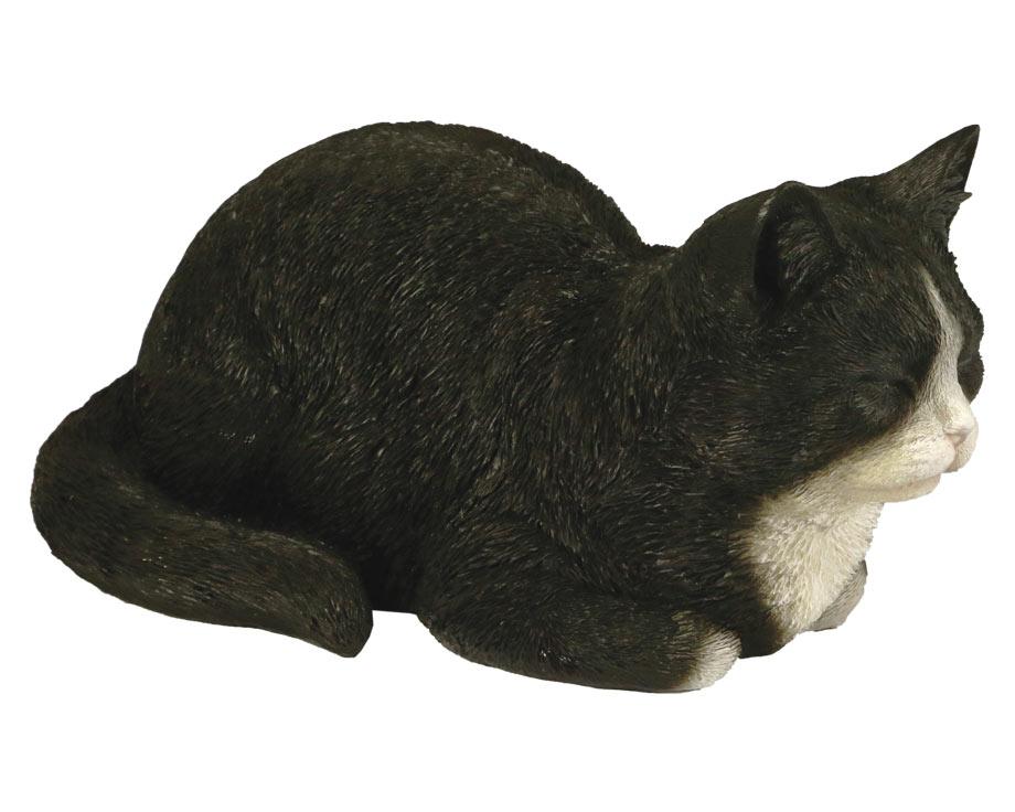 Chat dormant noir et blanc en résine